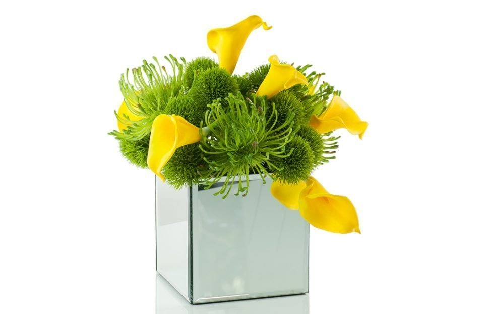 Faux yellow calla, green dianthus, pin cushion protea in mirror cube vase
