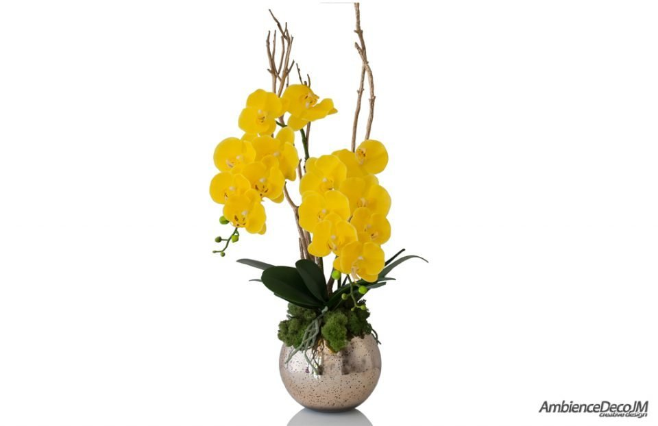 Artificial yellow orchids in a gold vase