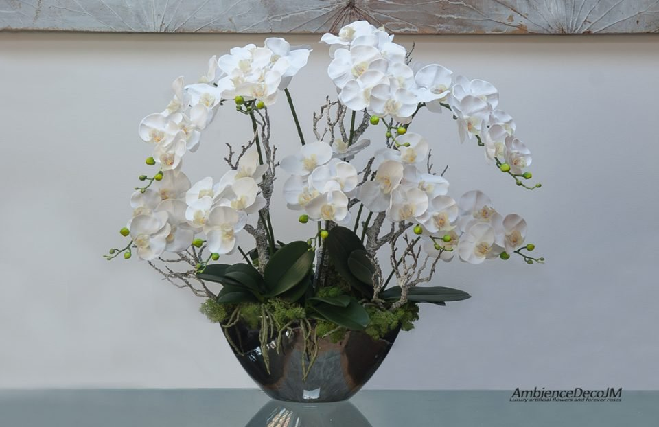 Luxury orchids in a mirrored boat vase