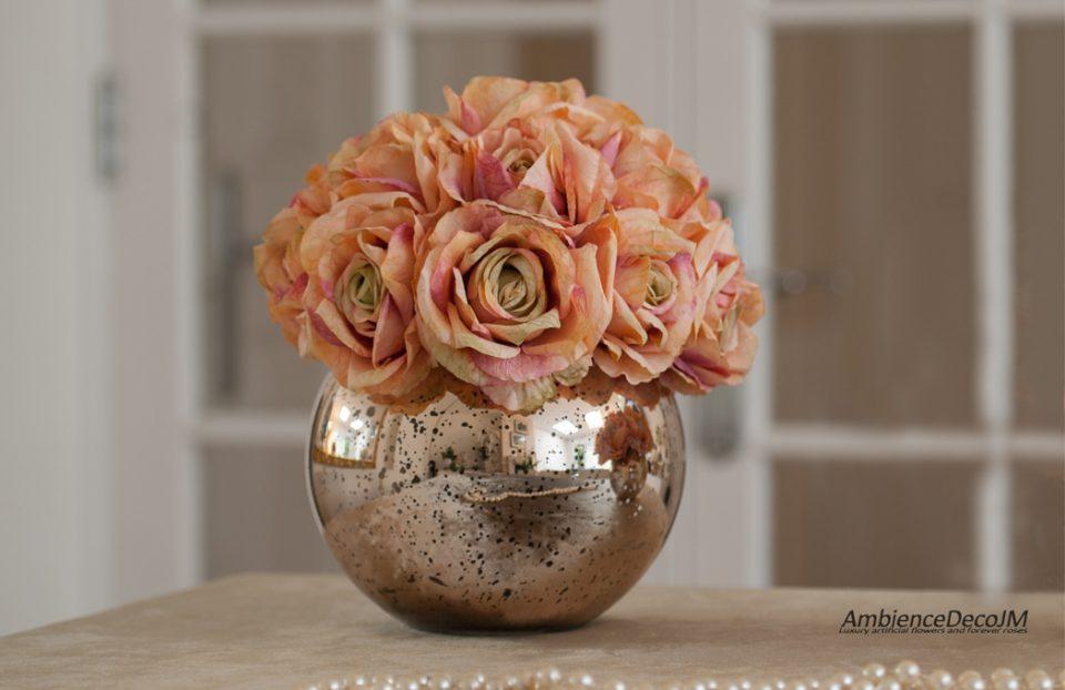 Silk tea roses in a fishbowl