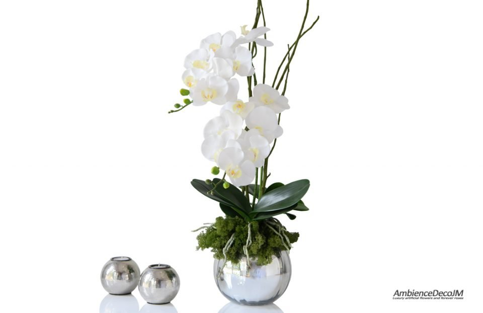 Lifelike orchids in a silver fishbowl