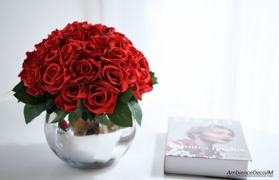Silk red roses in a vase