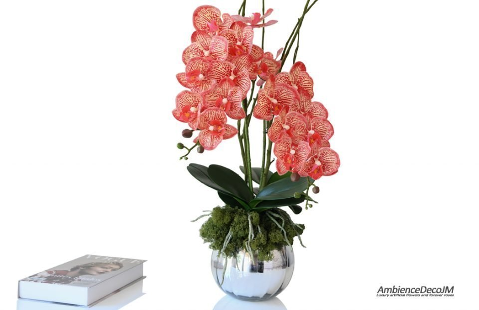 Lifelike red orchids in a vase