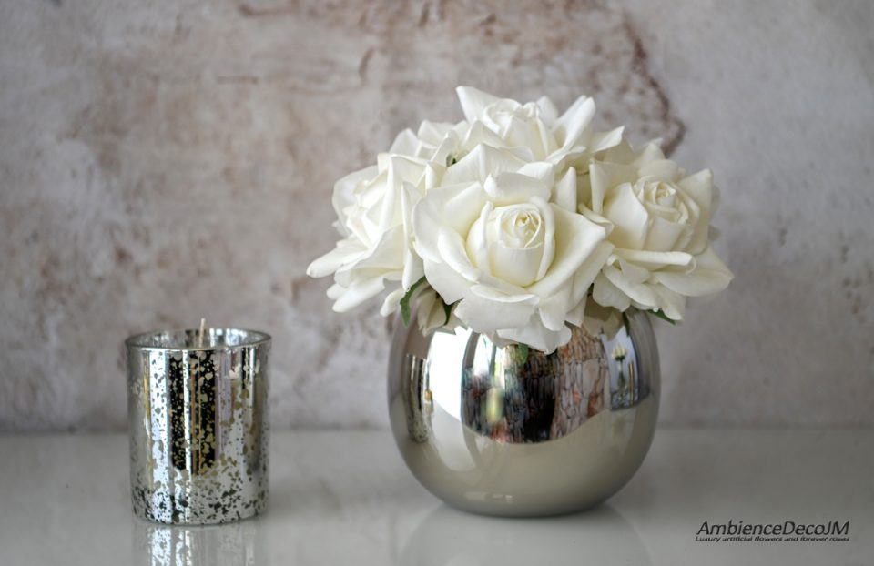 Real touch white roses in a vase