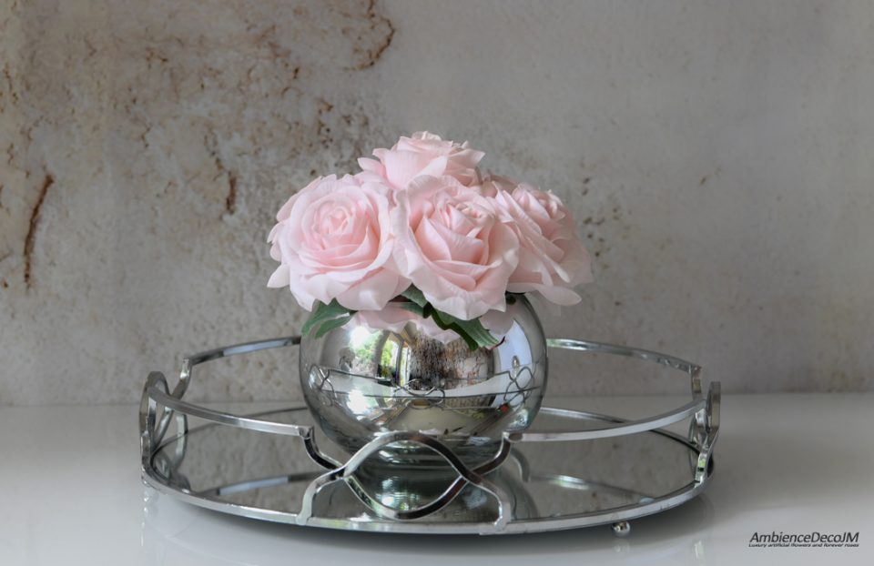 Artificial flowers in a glass vase.